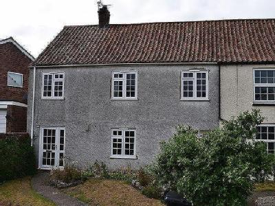 Four bedroom mid-terraced cottage in a favourable location in the village of Combwich, Somerset.