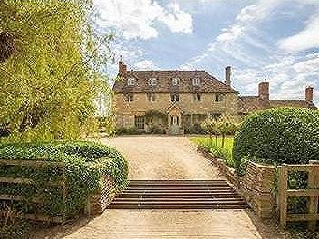Semington, Wiltshire. Beautiful farmhouse with glorious gardens, unconverted barns and paddocks